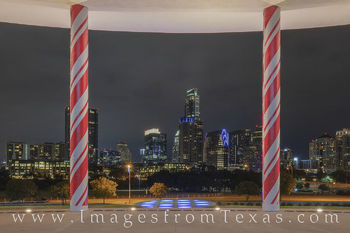 austin skyline, candy cane pillars, long center, austonian, holiday season, christmas, holiday, red and white, downtown, cityscape, zilker