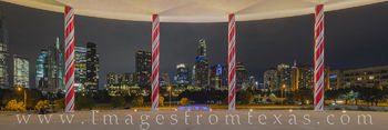 austin skyline; candy cane pillars; long center; austonian; holiday season; christmas; holiday; red and white; downtown; cityscape; zilker