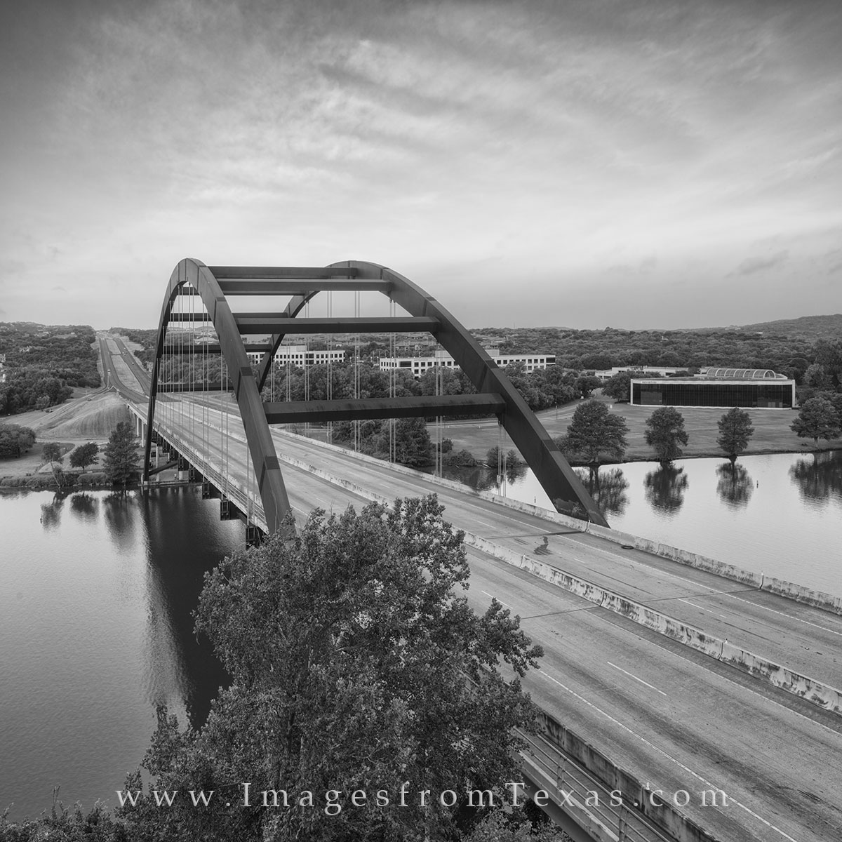 This black and white image from Austin, Texas, shows the local iconic landmark - the 360 Bridge - as it stretches across the...