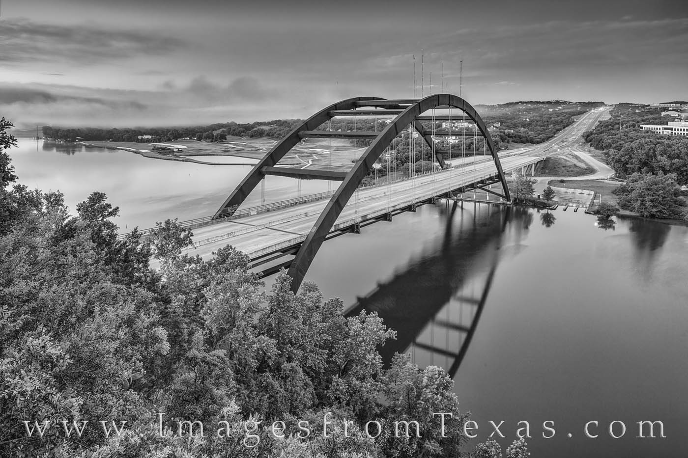 Looking over the Colorado River and iconic 360 Bridge, the famous overlook from where this black and white image was taken offers...