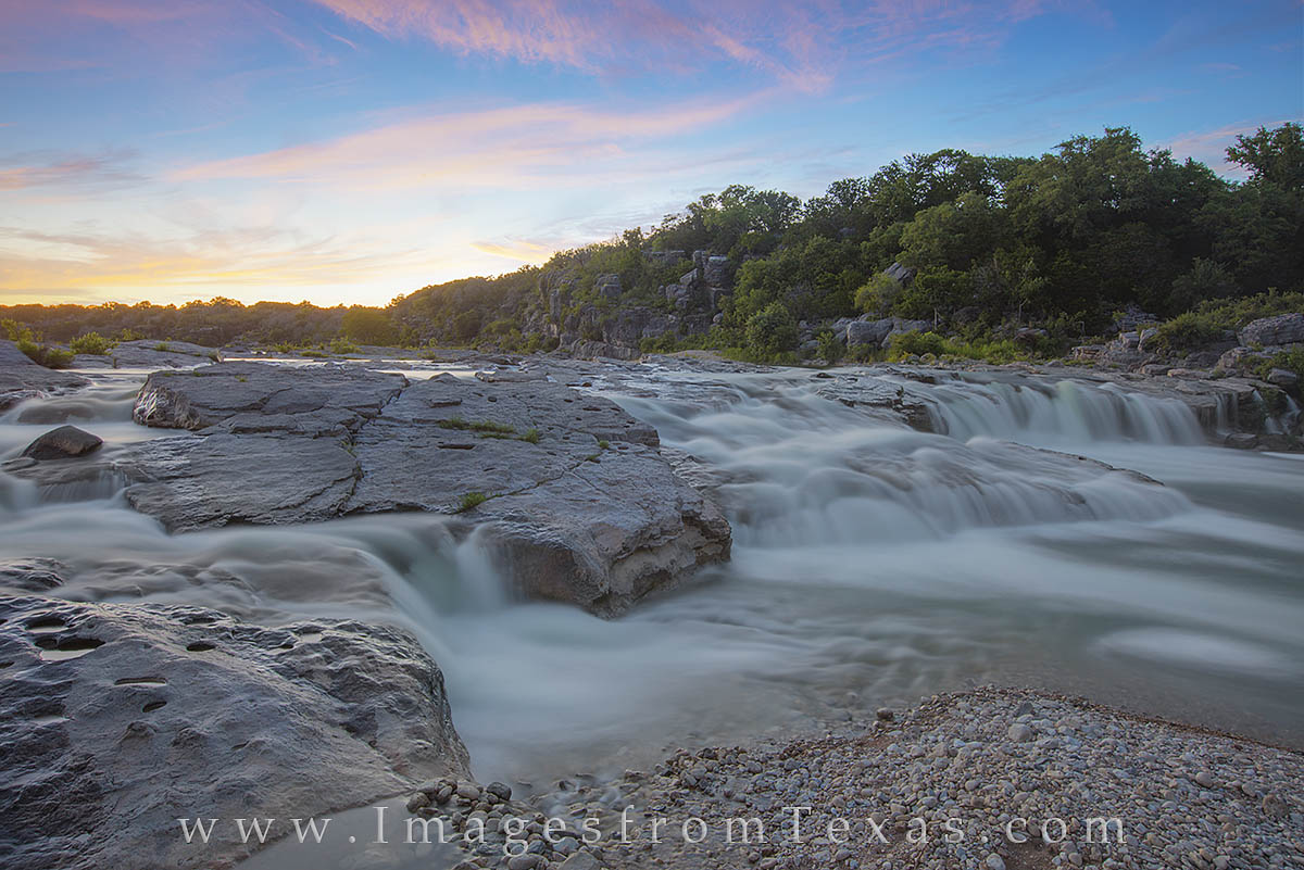 Soft evening light welcomes the end of a spring day over the Pedernales River. Landscape images like this are easy to find along...