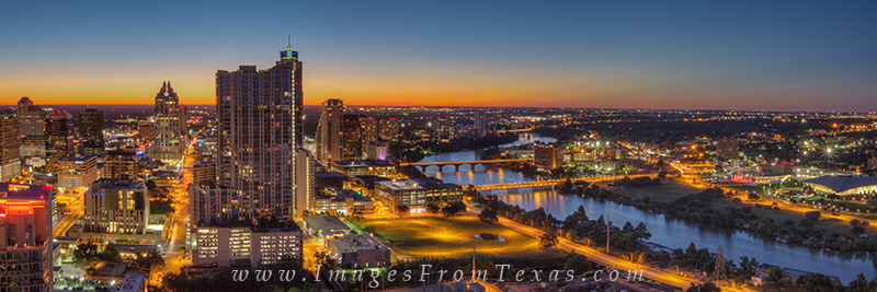 An orange glow lights up this Austin skyline panorama in the minutes before sunrise. In front is the 360 Condos with the well...