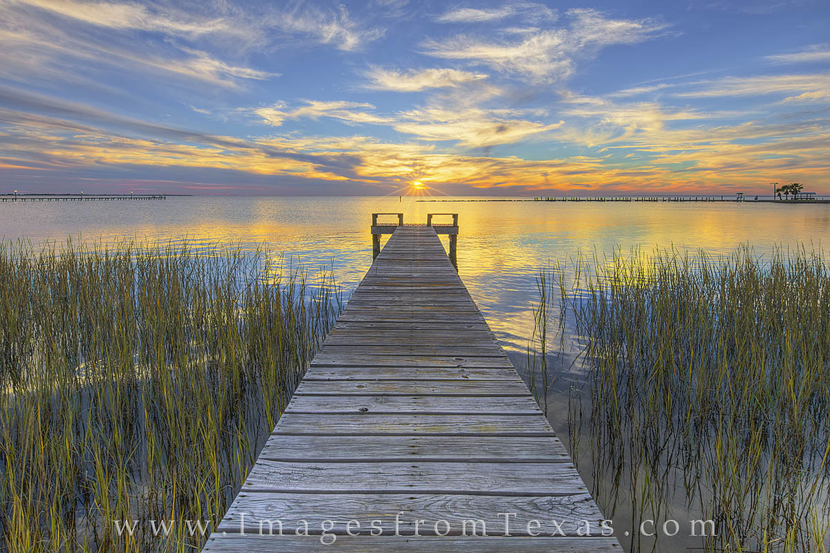 On a quiet evening along the shoreline of Copano Bay near Rockport, Texas, a beautiful sunset graced this tranquil September...