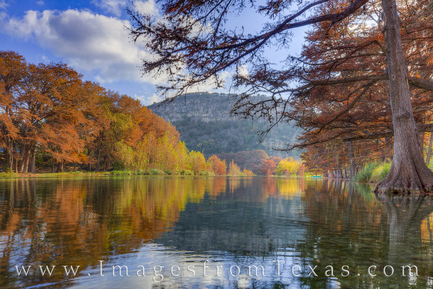 A calm Frio River in Garner State Park allowed for some amazing reflections of Mount Baldy and colorful cypress trees. The Autumn...