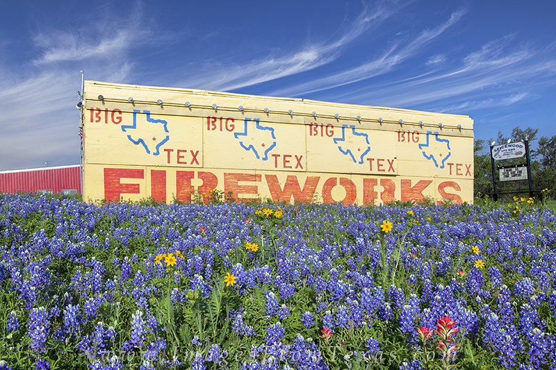 Along Highway 71 near Spicewood, Texas, this fireworks stand said it all - beautiful wildflowers lit up the roadside with red...