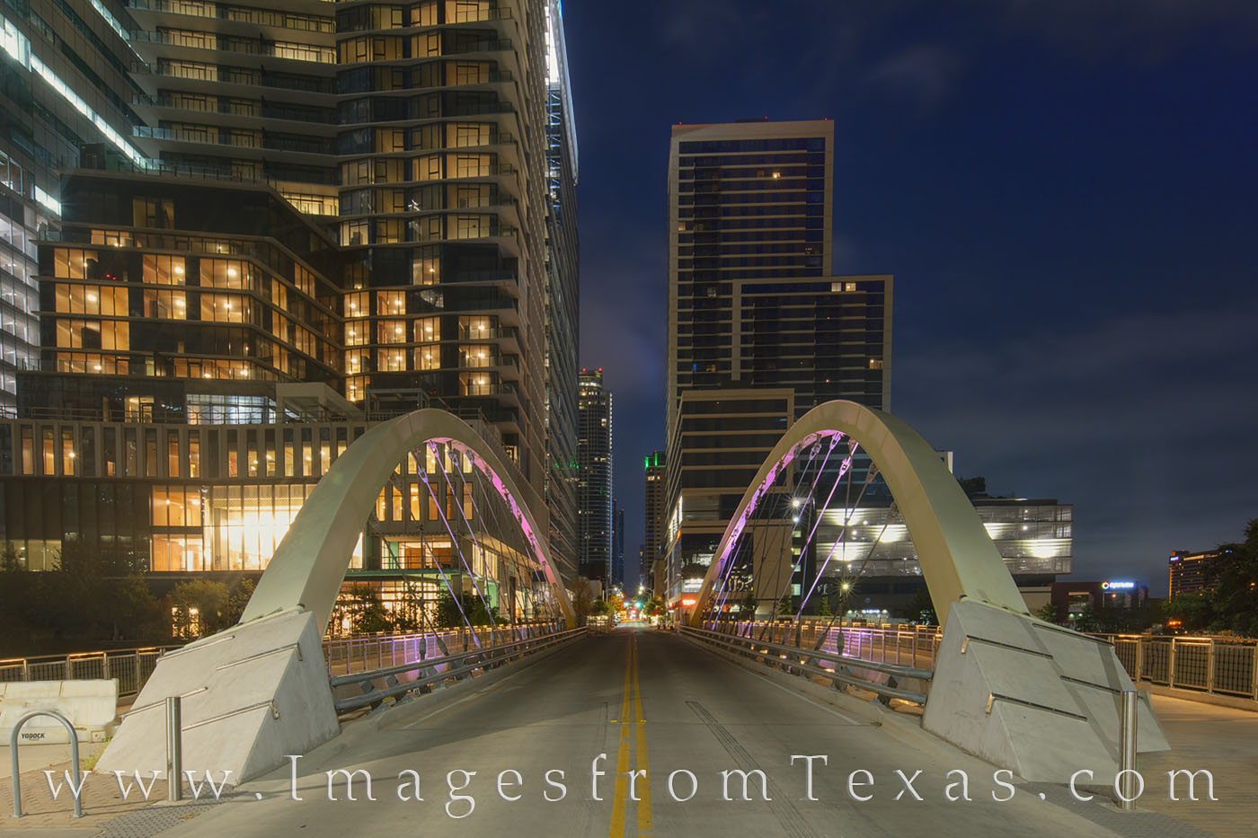 Well before sunrise in downtown Austin, the Butterfly Bridge crosses Shoal Creek and shows off the colorful lights used to illuminate...