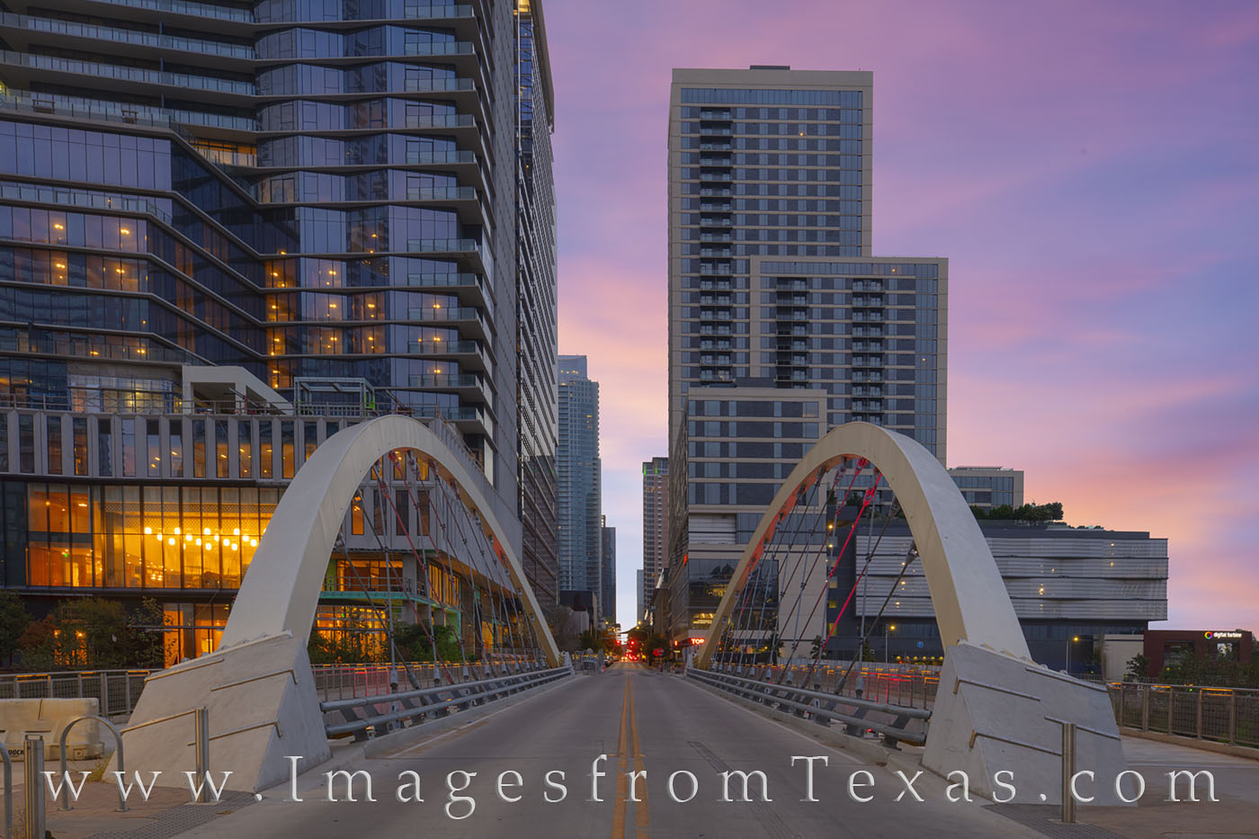 Butterfly Bridge crosses Shoal Creek near West Avenue on a summer morning in this photograph from downtown Austin. Not far to...
