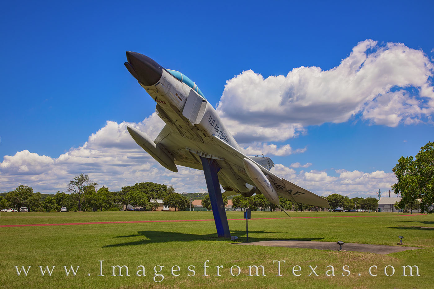 At Camp Mabry in Austin, Texas, a F4 Phantom is on display outside the walls of the Texcas Military Museum. Several other fighters...