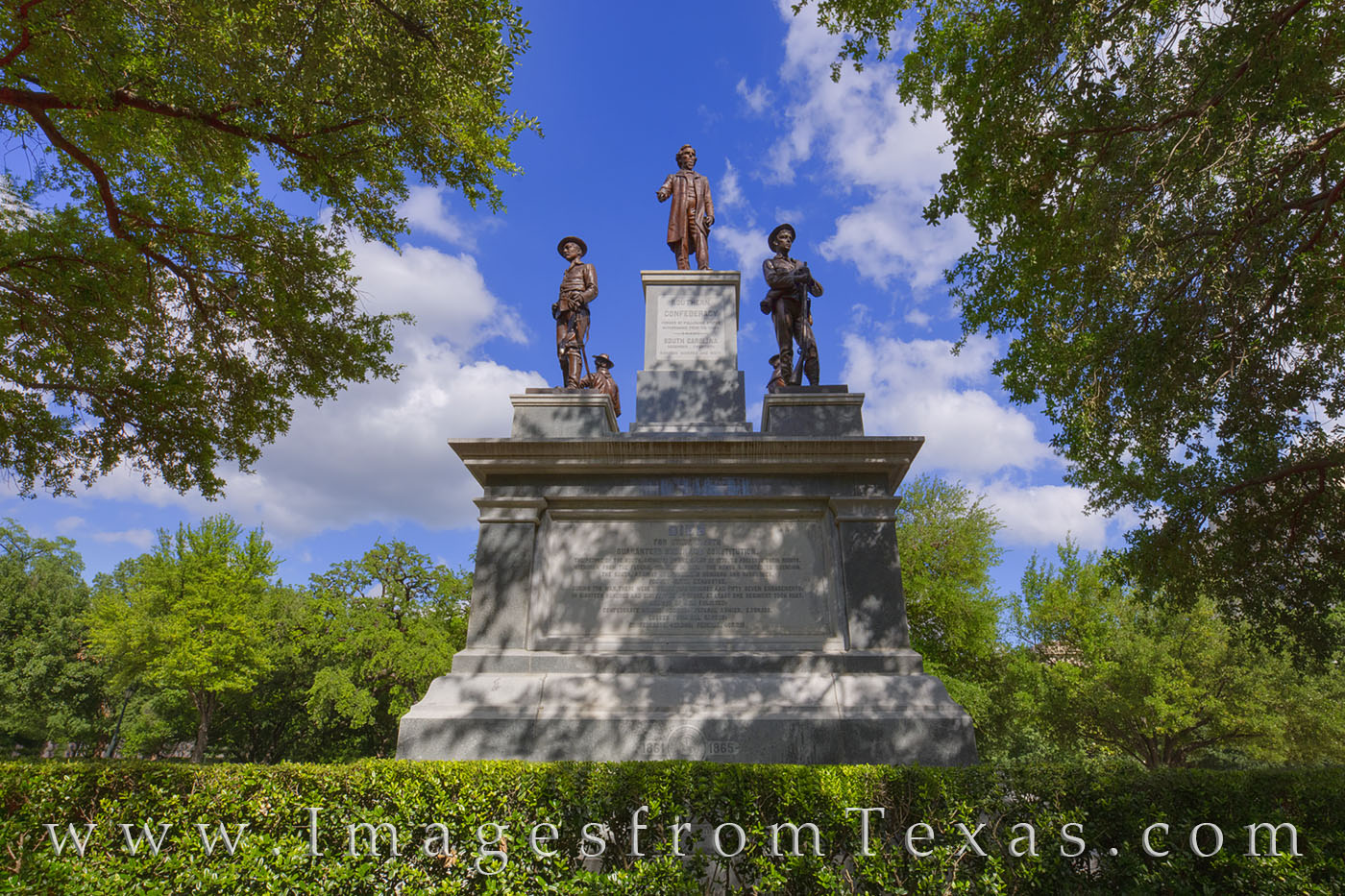The Confederate Soldiers Monument was erected in 1903 by surviving comrades of the fallen soldiers. The sculpture was Pompeo...