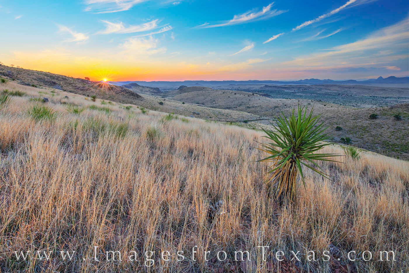From the slopes of the Davis Mountains, the sun shows the first rays of daylight on a warm summer morning.
