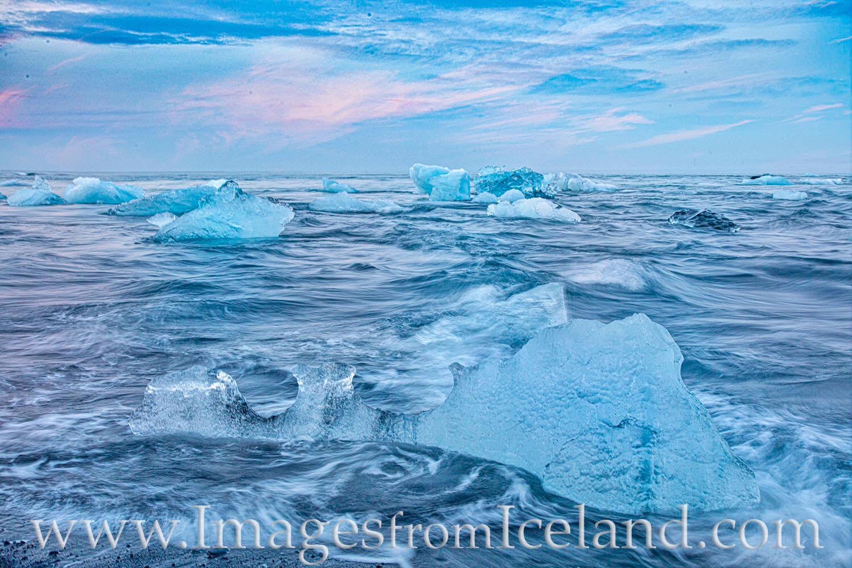 Icebergs break off from Breiðamerkurjökull glacier and float from Jökulsárlón Bay out to sea. However, the tide often...