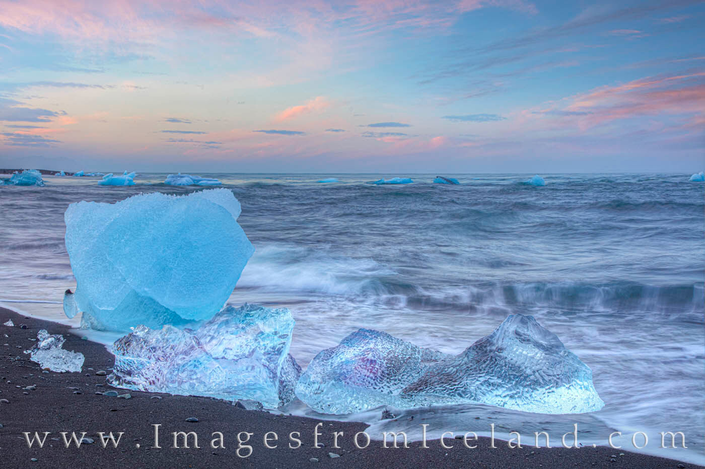 Icebergs rest after a tumultous float through Jökulsárlón Lagoon, out into the North Atlantic Ocean, and back up on Diamond...