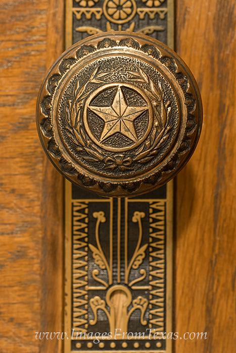 The ornate craftmanship of a doorknow to the Texas state capitol is shown here.