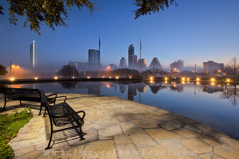 Low fog drifts through the downtown area of Austin, Texas in this photograph taken from a small pool near the Long Center. I...