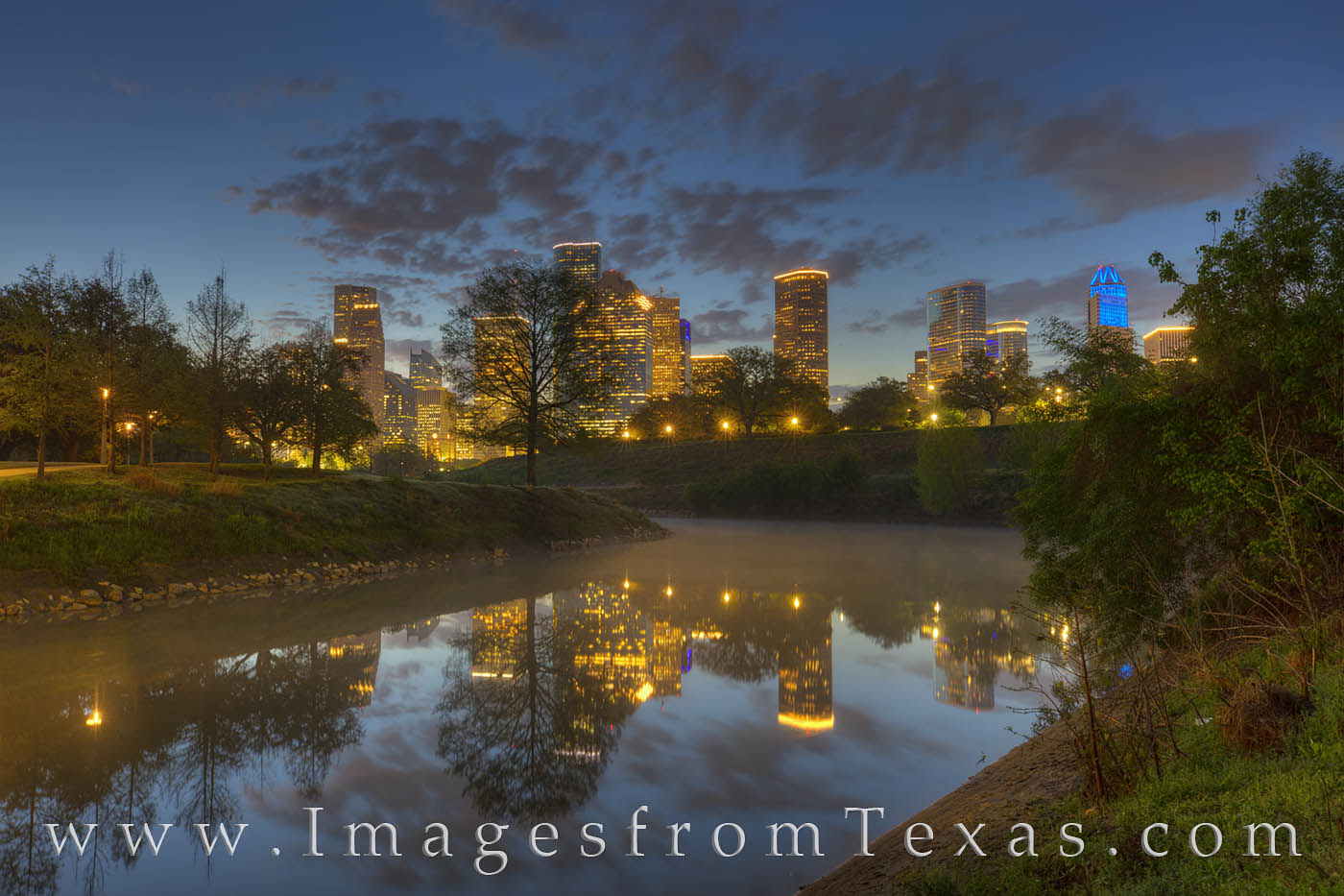 The Houston skyline is beautiful at sunset or sunrise. Here, seen from Buffalo Bayou, the lights still flicker in the early morning...
