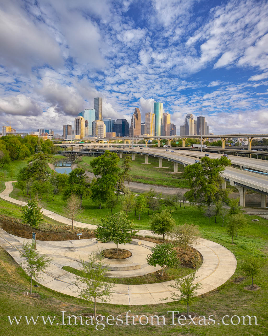 From a small drone, this view shows the Houston skyline on a beautiful March afternoon. The greenbelt of Hogg Park shows off...
