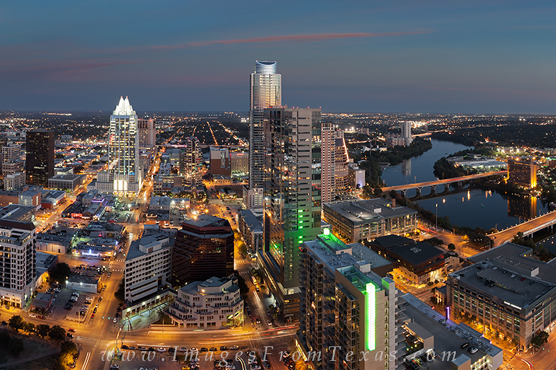 austin cityscape,frost tower,austonian,lady bird lake,austin at night, photo