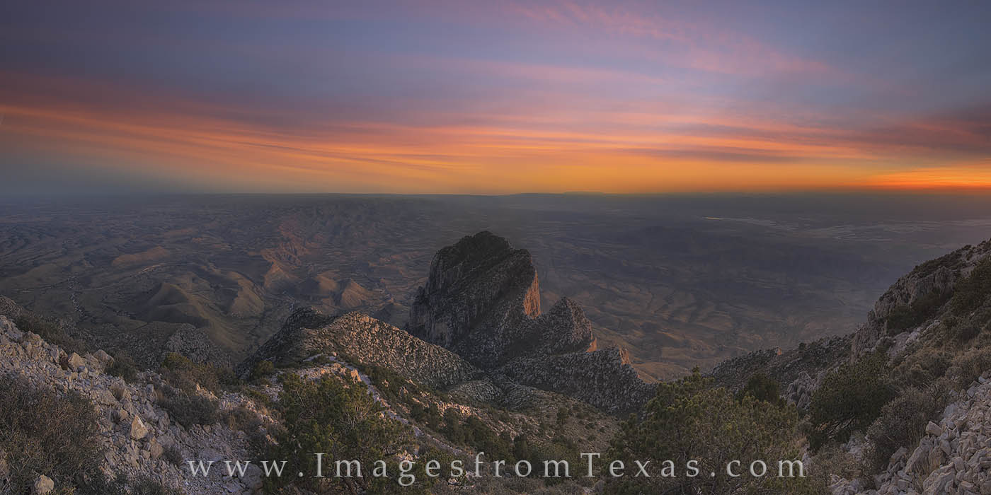 This panorama taken on Guadalupe Peak, the tallest summit in Texas at 8,751 feet, shows the southwest sky at sunset on a fall...