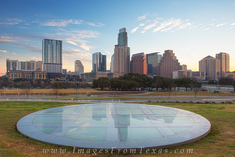 A thin layer of dew covered the ground on this cool February morning. While I've photographed the Austin skyline several times...
