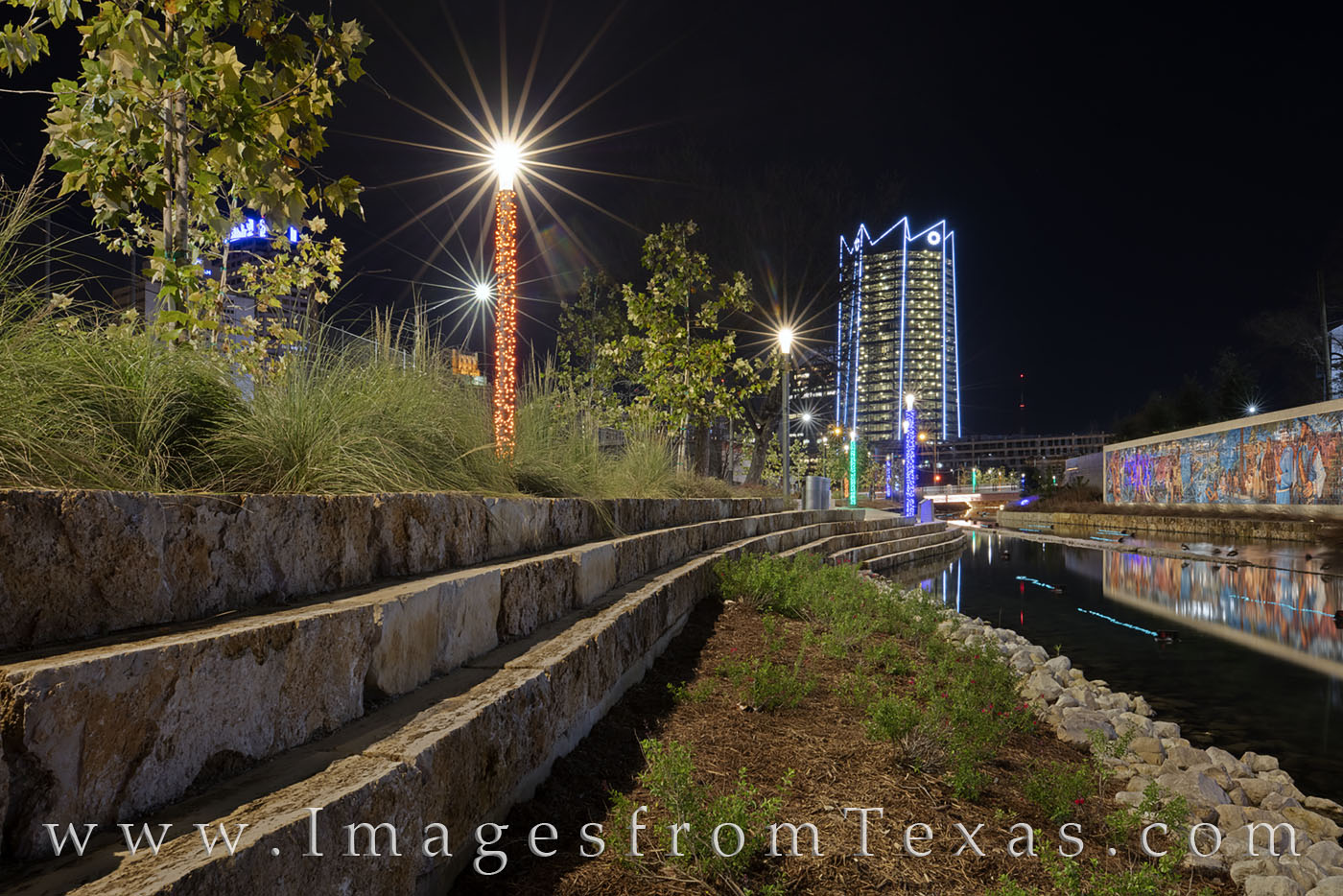 The Frost Tower rises into the night as seen from the San Pedro Creek Culture area. Taken on a cold winter evening, this image...
