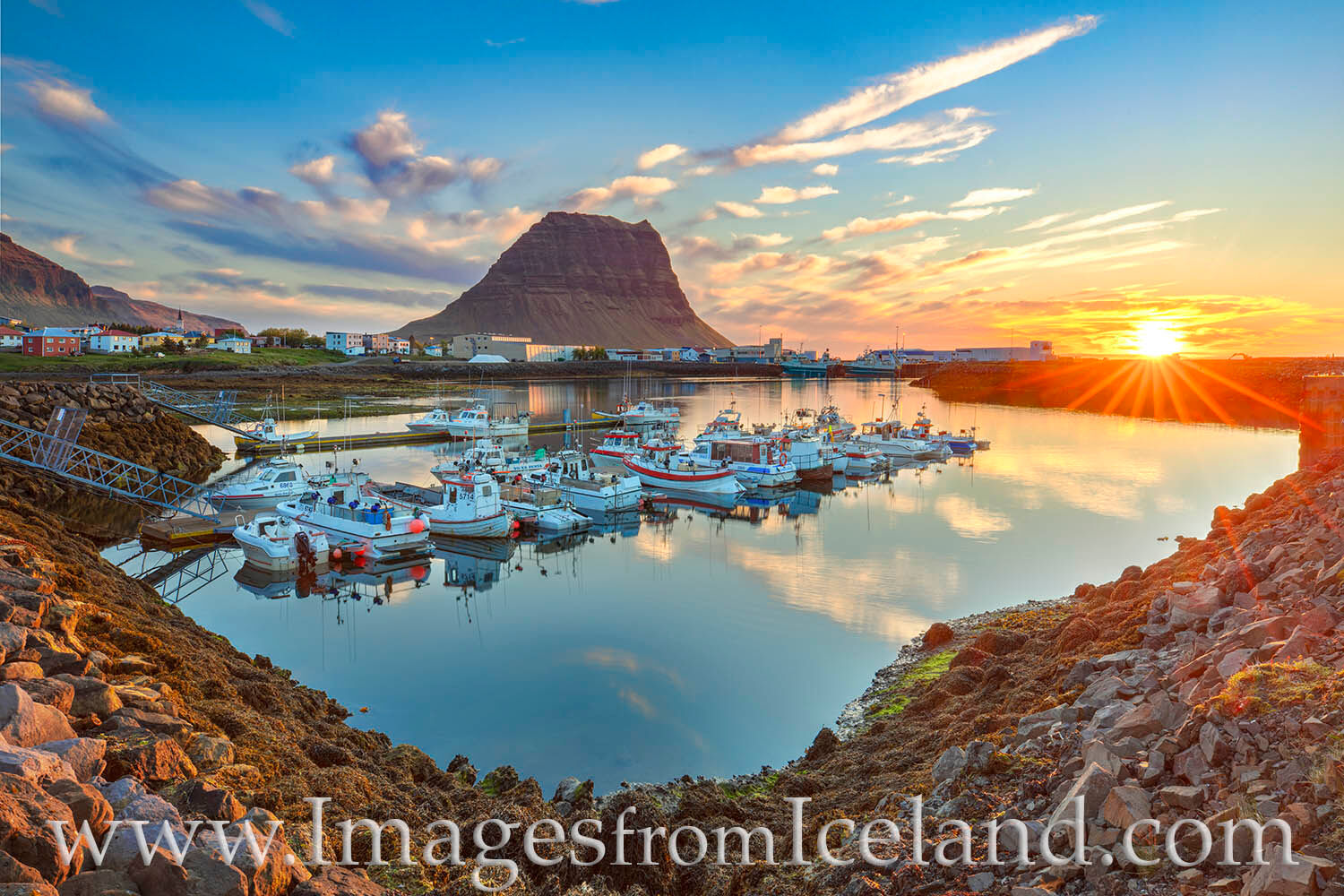 On a summer eve when the sun barely falls below the horizon -- and even then for a very brief time -- the harbor at Grundarfj...