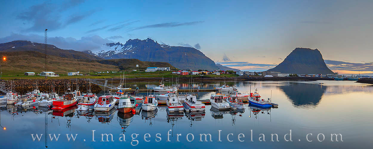 On a quiet summer morning in west Iceland about 2:00am, the boats in Grundarfjörður harbor are still in the cold air. In the...