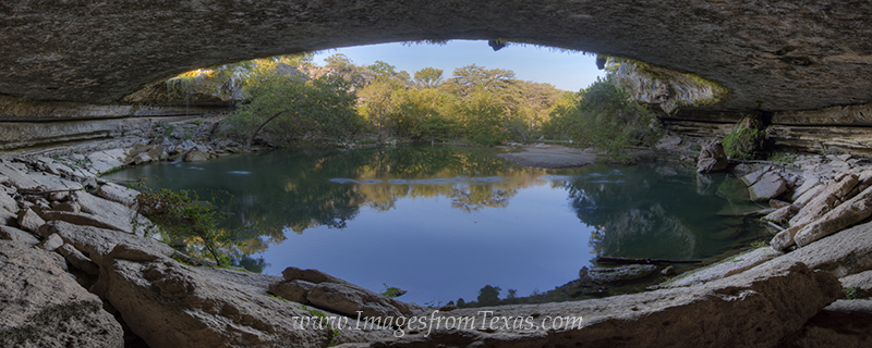 From the back of the grotto at Hamilton Pool, this panorama shows the entire area on a blue sky Autumn afternoon. Nestled in...