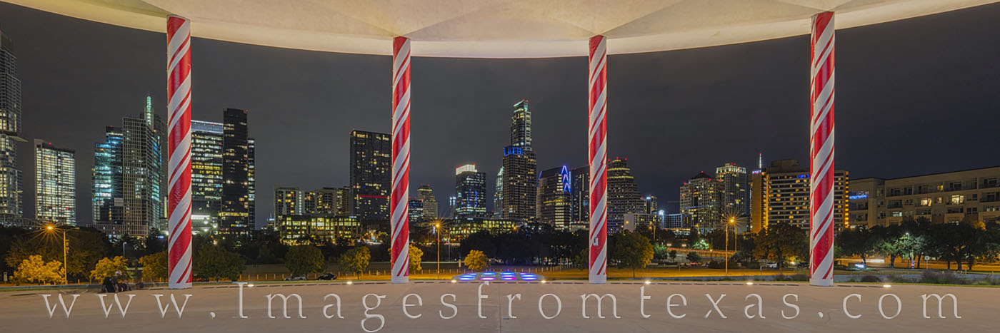 austin skyline; candy cane pillars; long center; austonian; holiday season; christmas; holiday; red and white; downtown; cityscape; zilker, photo