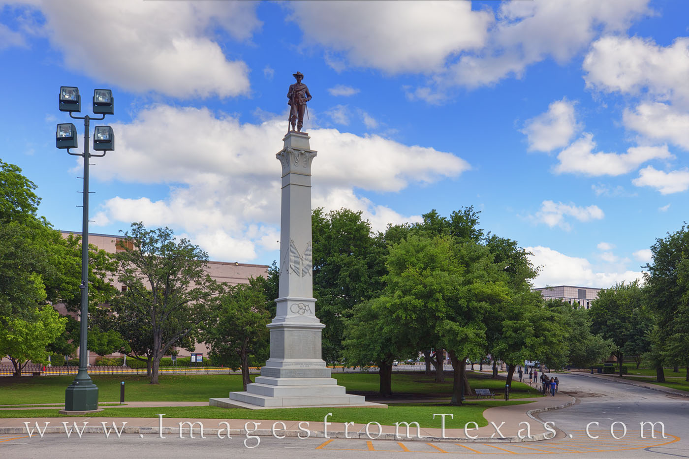 Hood's Texas Brigade Monument stands tall on the grounds of the Texas State Capitol. The figure at the top shows a confederate...