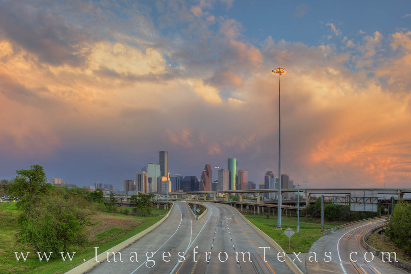 After afternoon storms had passed through downtown Houston, the skies began to clear as the sun setting in the west lit up the...