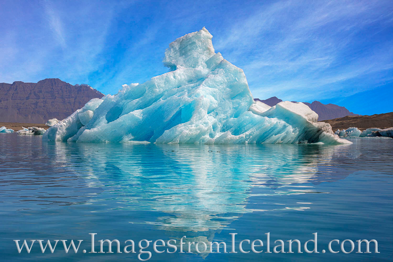 In  Jökulsárlón Bay, blocks of ice over 1,000 years old break off from Breiðamerkurjökull glacier and drift in the clean...