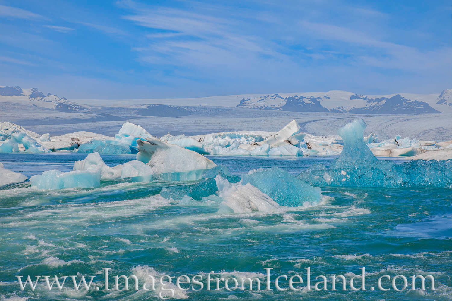 Icebergs pile up at the exit of Jökulsárlón Bay on their way out to the Atlantic. Ninety percent of the iceberg is underwater...