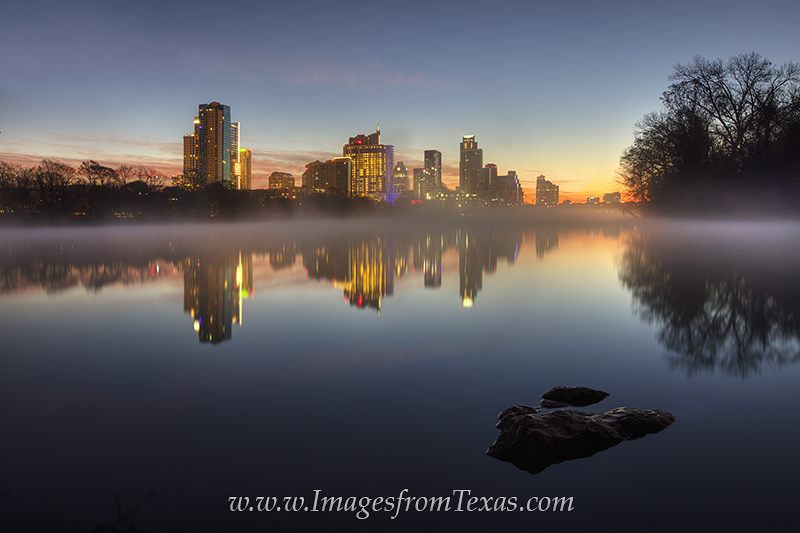On a frigid January morning, steam rises off of Lady Bird Lake as the first light of day begins to show over the downtown Austin...