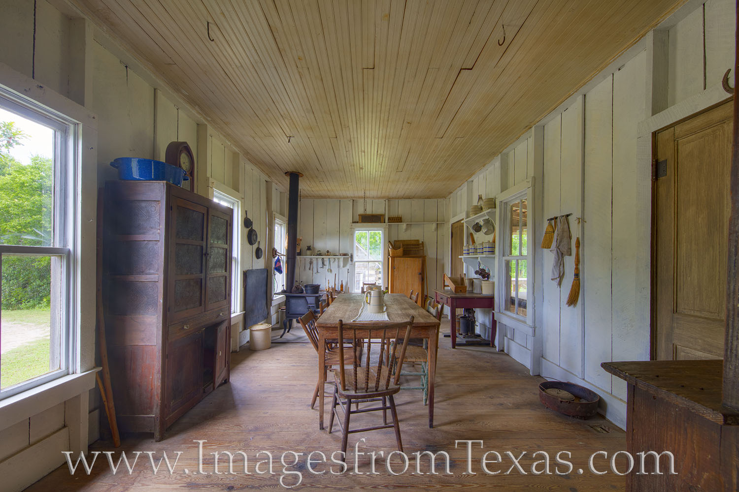 This interior view shows the kitchen of an old homestead. Visitors at the Jourdan-Bachman Pioneer Farm are invited to explore...
