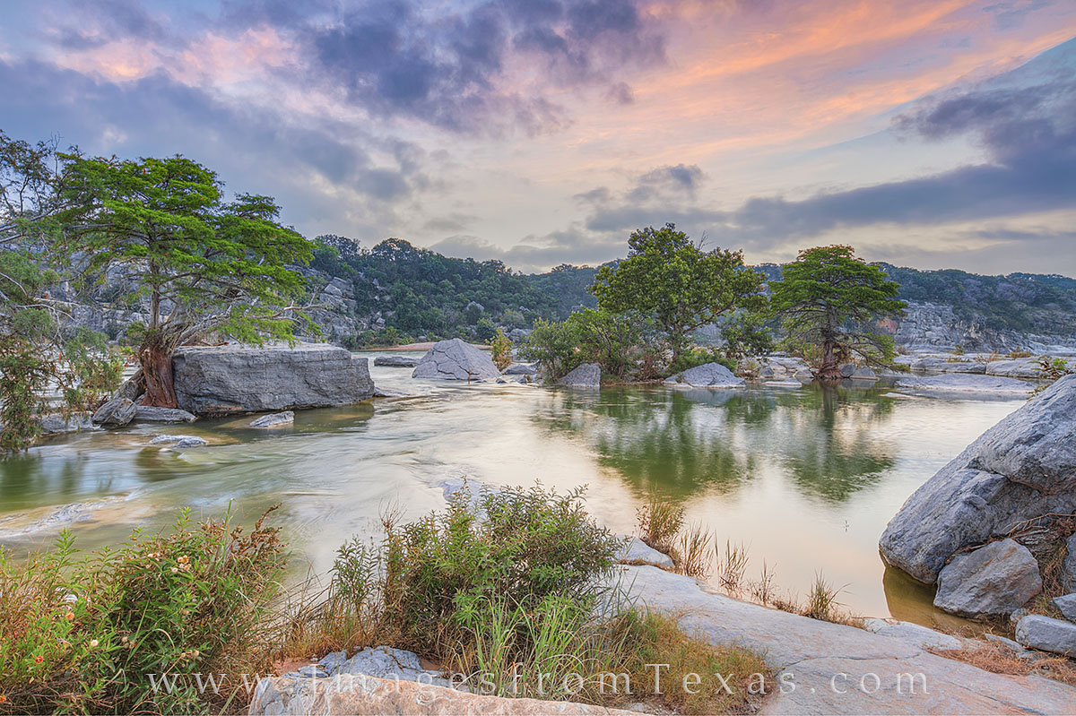 Pink and blue pastel colors filled the morning sky over the Pedernales River in the Texas Hill Country on this June morning....