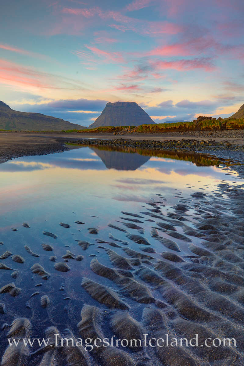 The light of the midnight sun keeps west Iceland far from darkness on summer nights. Seen here, Kirkjufell Mountain rises in...
