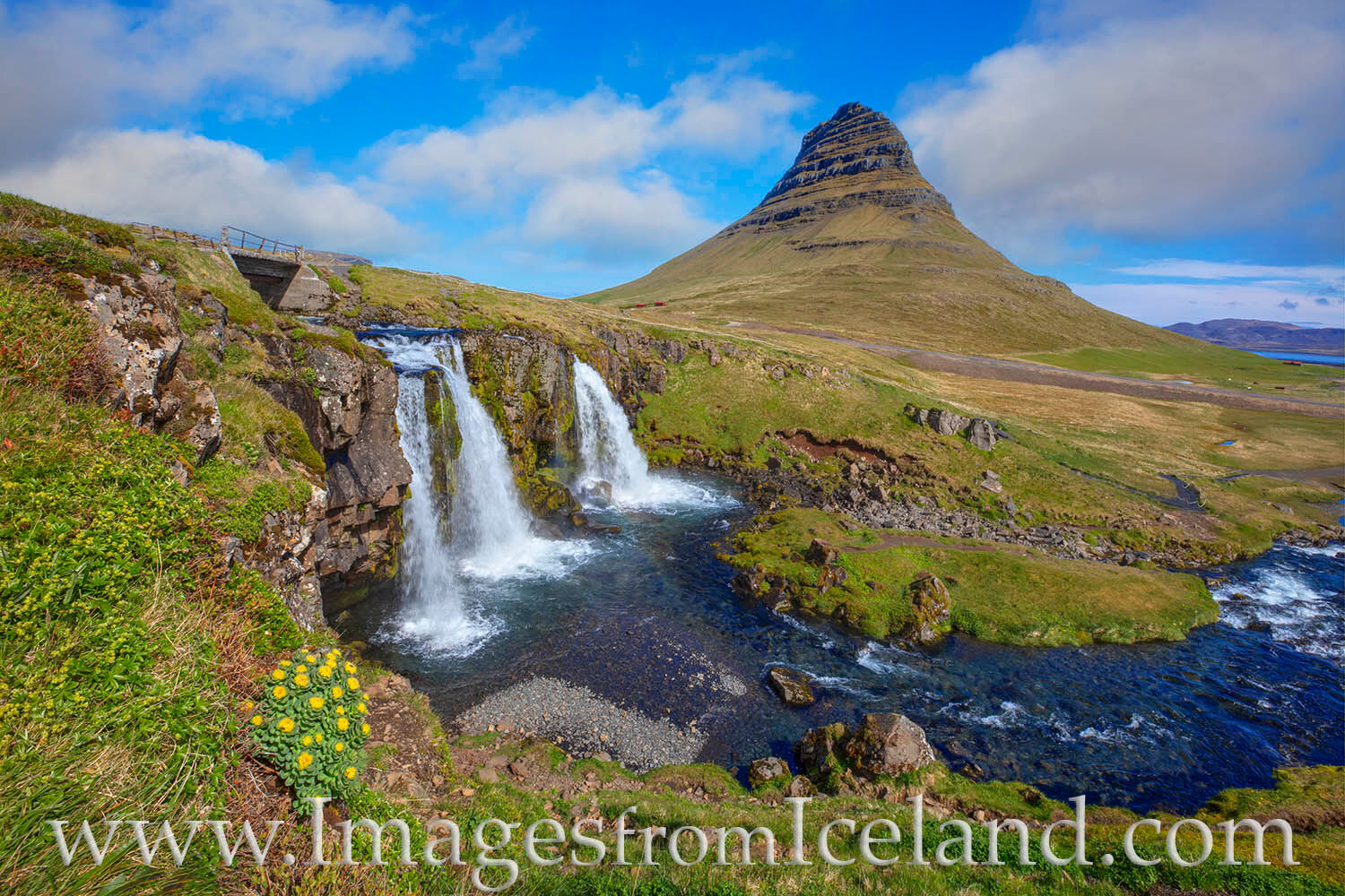 In the morning light, Kirkjufell Mountain rises 1,519' (463m) into the cold air. Kirkjufellfoss, the waterfall in the foreground...