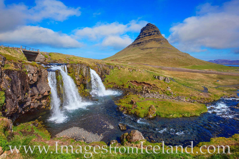 The waterfall known as Kirkjufellfoss flows beneath the iconic summit of Kirkjufell Mountain in the Snæfellsnes Peninsula. Just...
