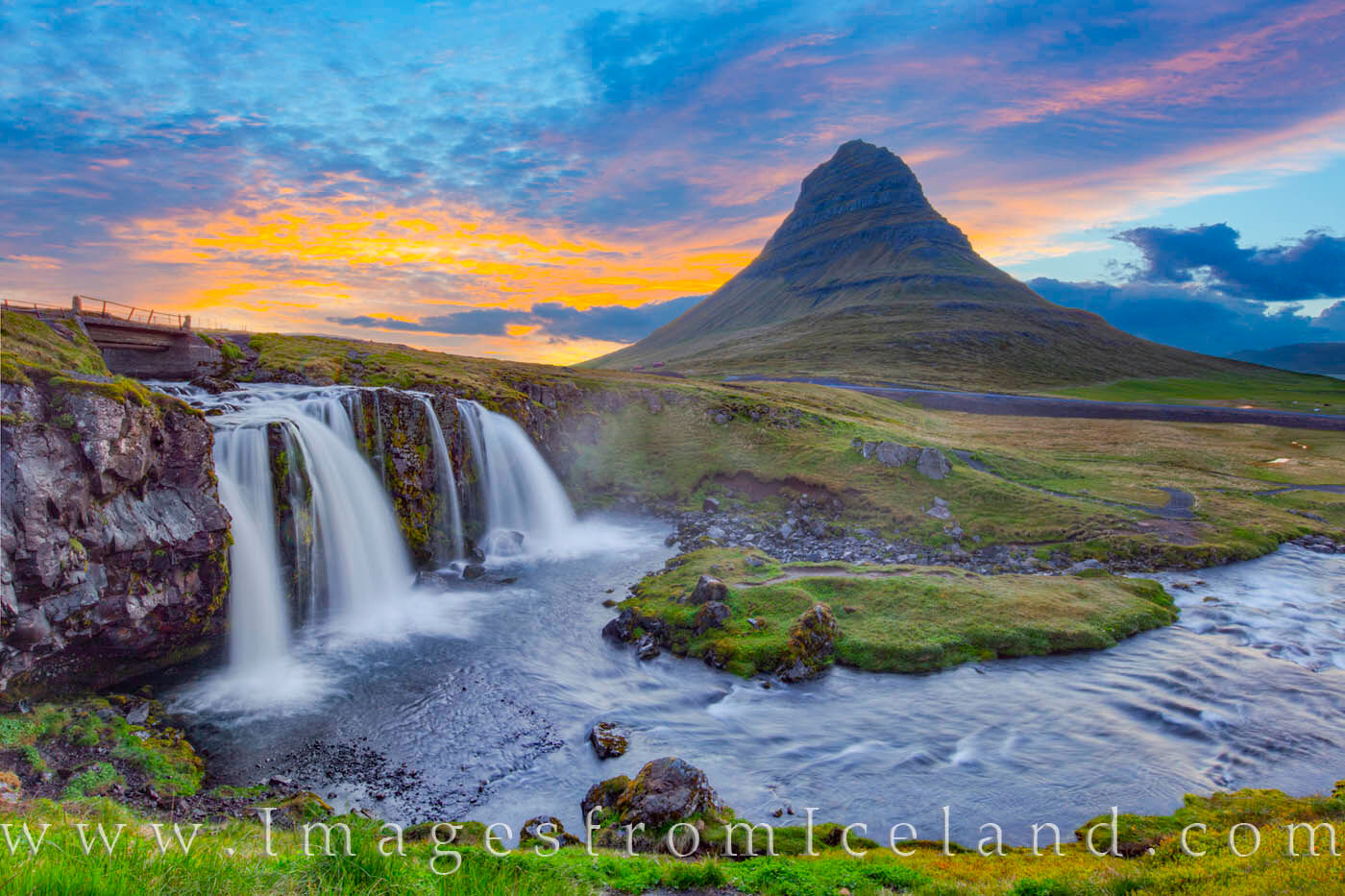 This photograph is one of a series of images showing Kirkjufell Mountain under a beautiful sky just after midnight as the clouds...