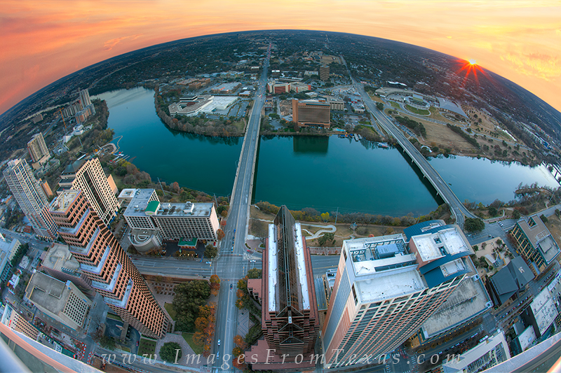 From the top of the Austonian, this image from the skyline of Austin shows Lady Bird Lake, Zilker Park, the Congress Bridge...