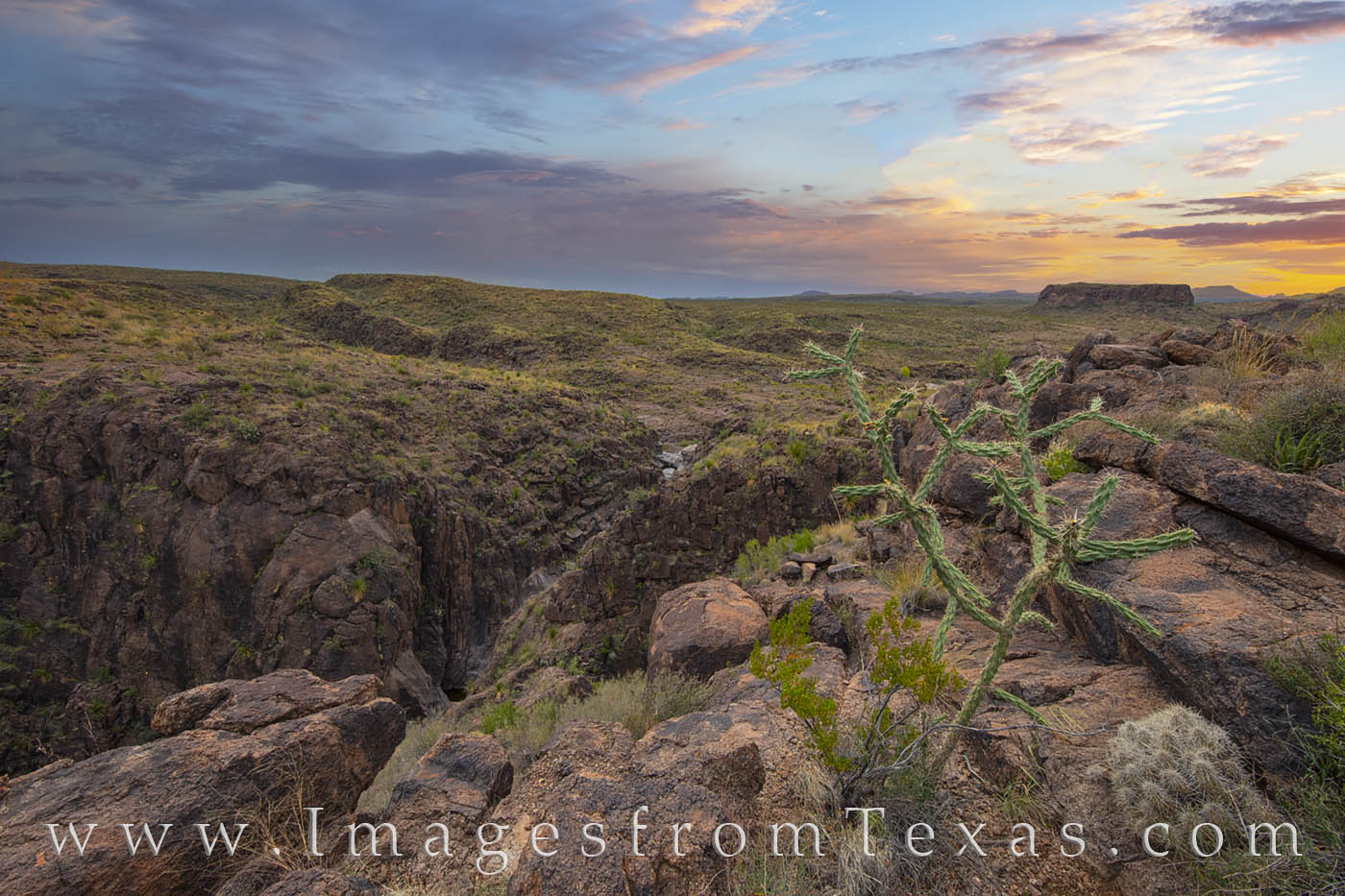 "In the fading light, a small canyon runs through the rugged landscape of Big Bend Ranch State Park - just on the ""other side..."