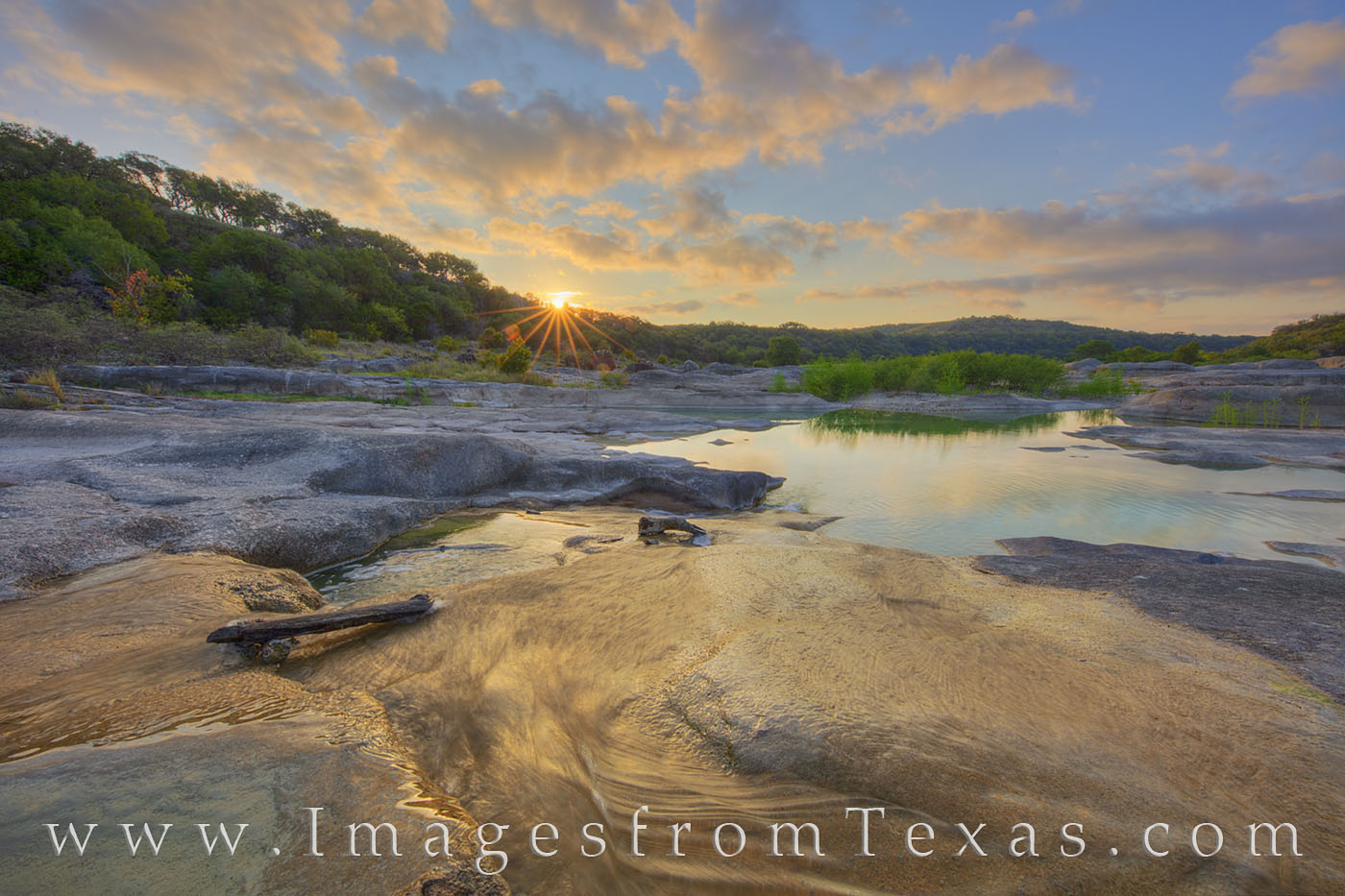 As water flows over the age-old limestone rock along the Pedernales River, the sun breaks over the distant horizon, ushering...
