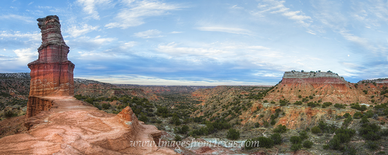 With a nearly-full moon rising in east, the iconic rock formation the Lighthouse at Palo Duro Canyon stands tall in the crisp...