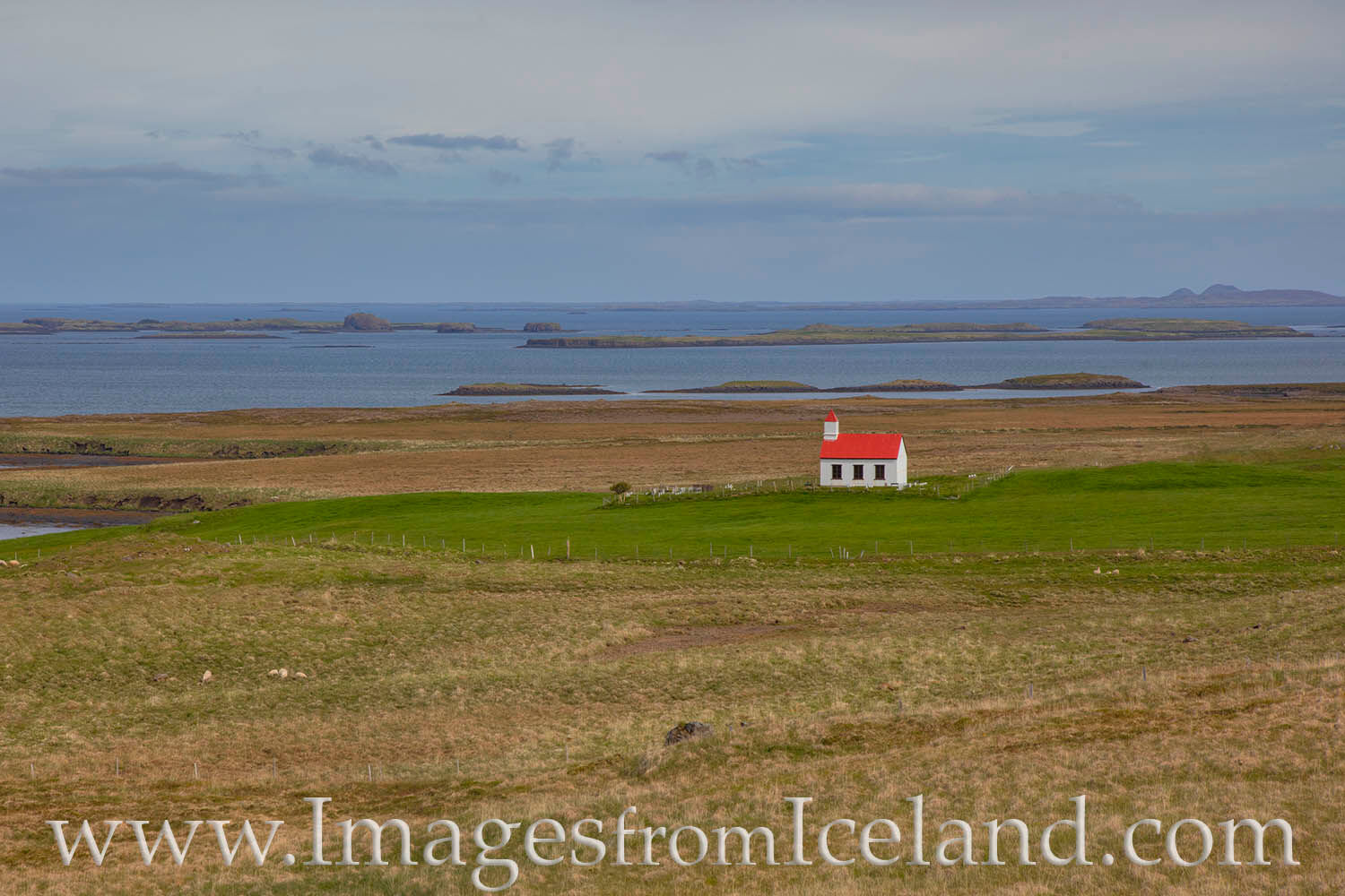 This lonely church sits along the coast in west Iceland. On a long drive on a dirt road between Grundarfjörður and Husavik...