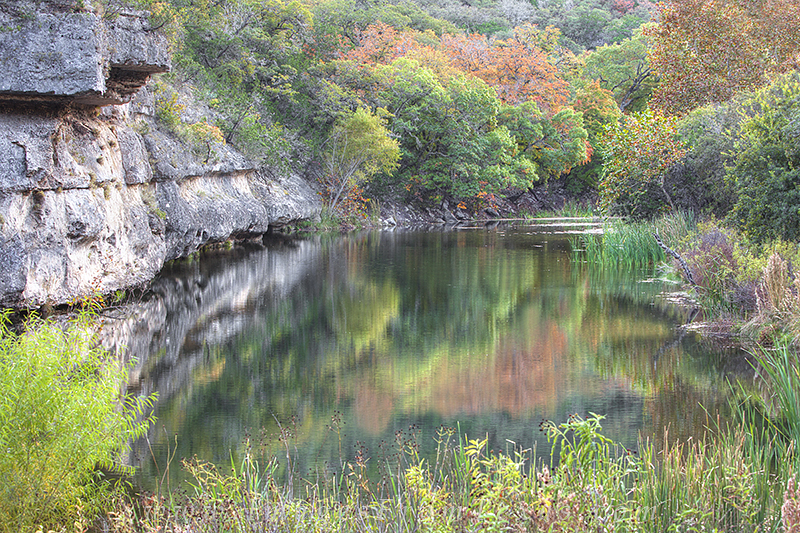 On the East Trail near a primitive campsite, this lovely pool offers reflections of red, orange, and gold when the Bigtooth maples...