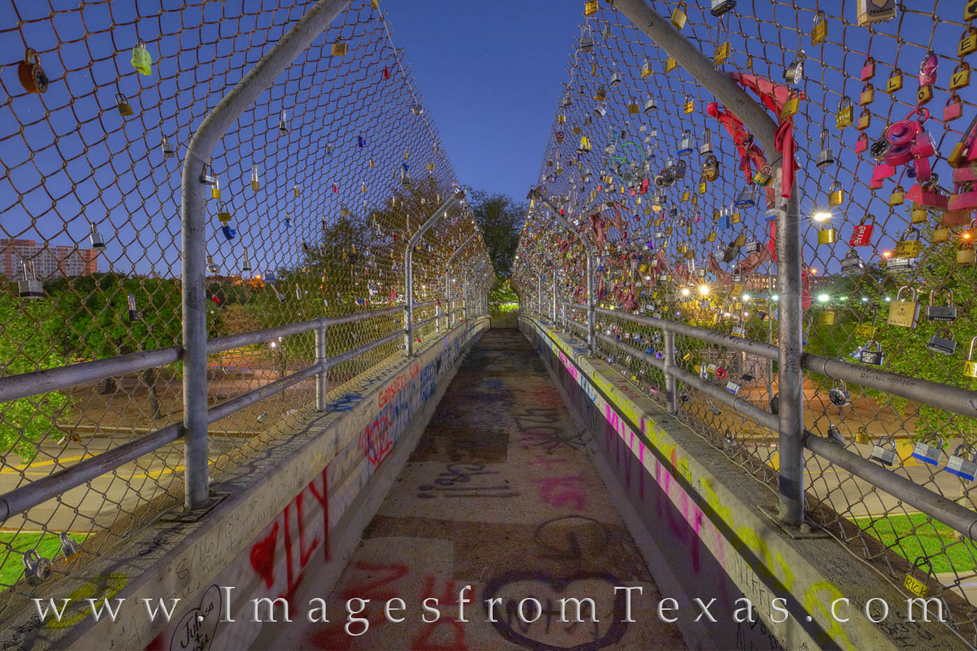 The famous Love Lock Bridge passes over Allen Parkway near downtown Houston, Texas. The locks are placed their by lovers declaring...