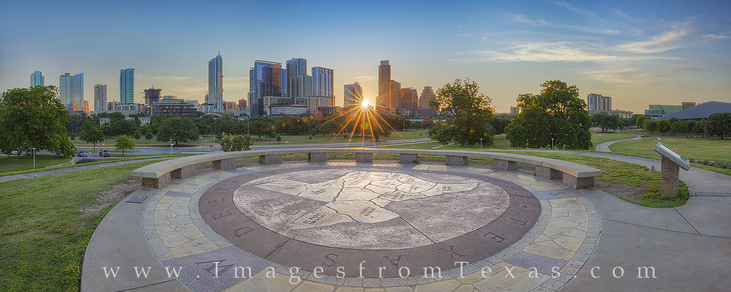 On a still, quiet May morning, the sun rises over downtown Austin, Texas. The skyline and high rises come to live in this wide...
