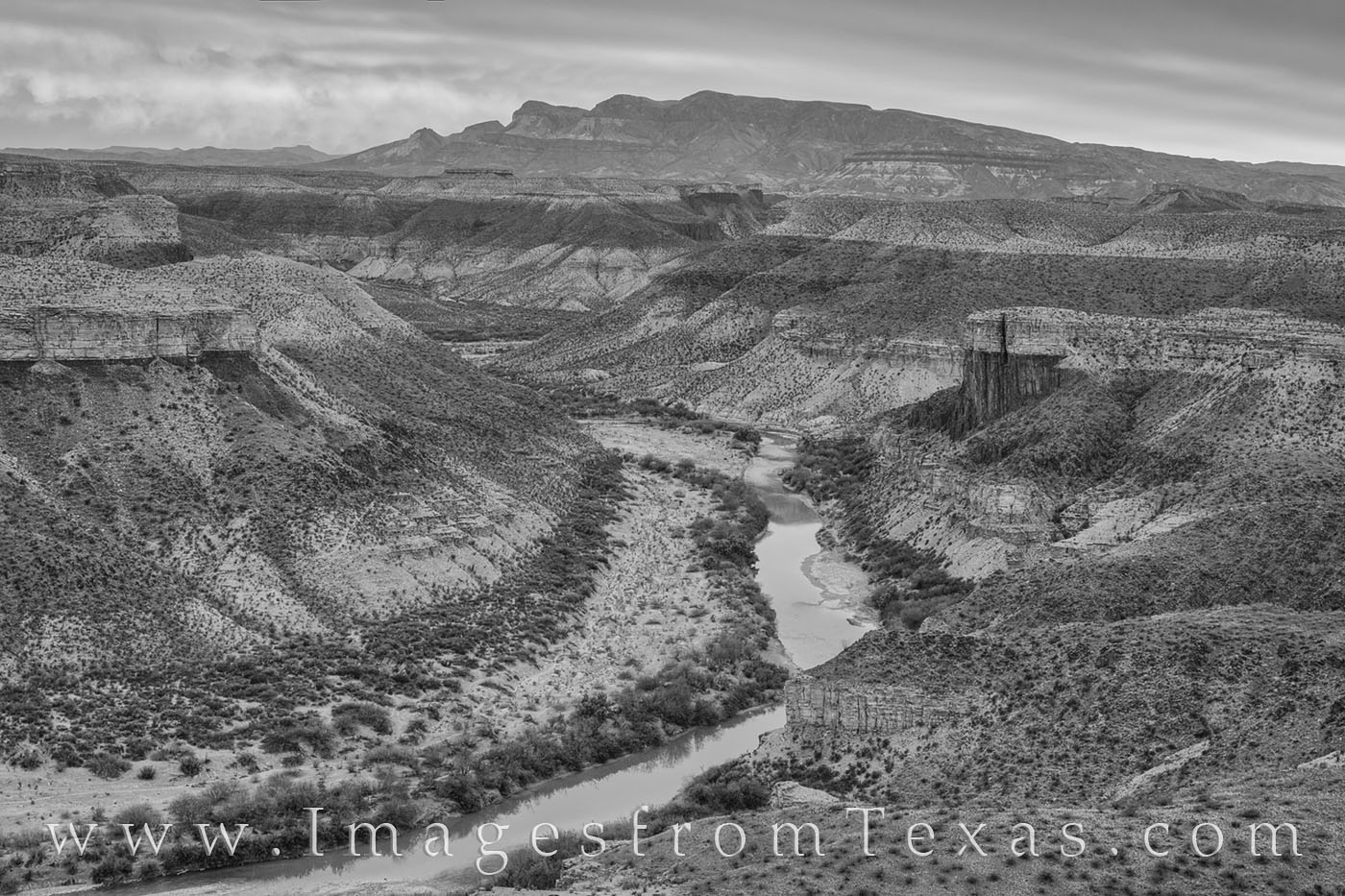 This black and white image from Big Bend National Park shows a bend in the Rio Grande from high up on the Mesa de Anguila. This...