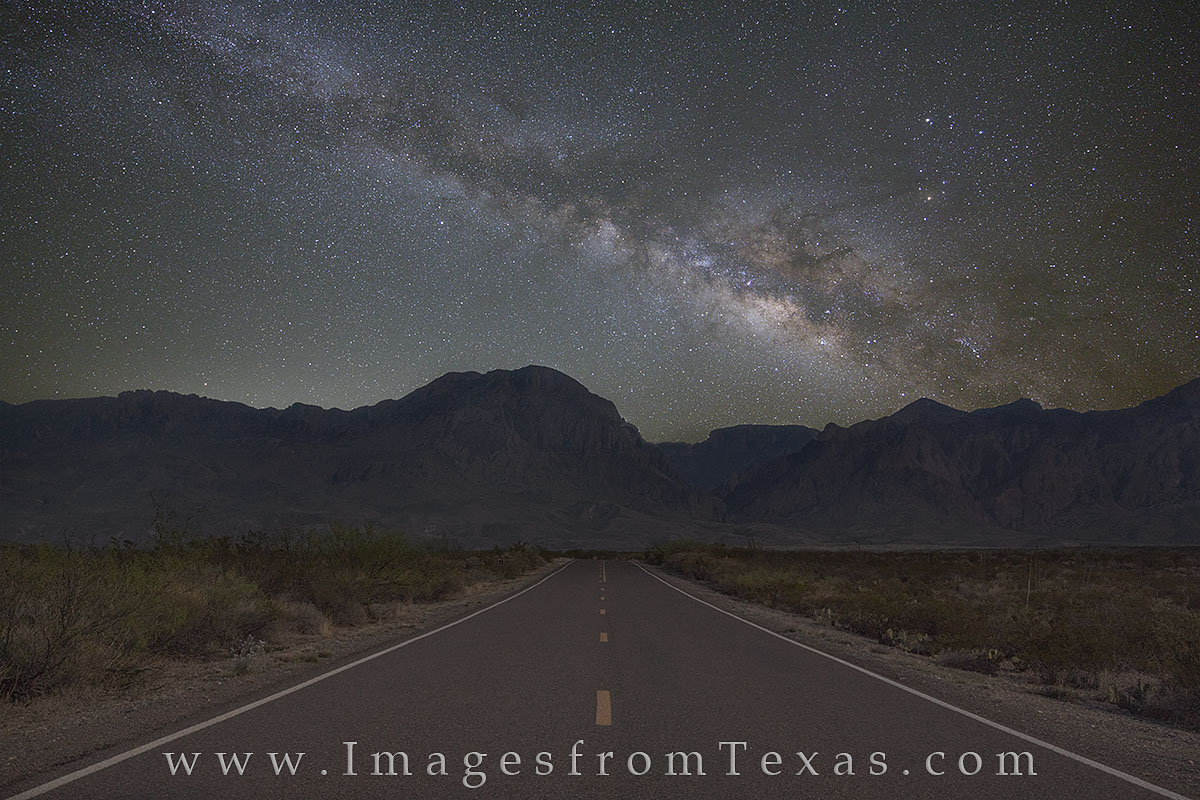 Facing Southeast, a portion of the Ross Maxwell Scenic Road heads towards the Chisos Mountains in the hours before sunrise. I...