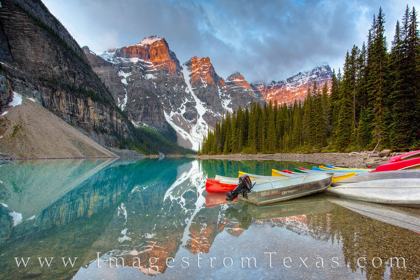 Early morning at Moraine Lake in Banff National Park, and the waters are quiet. The colorful boats are still ashore and the tourists...
